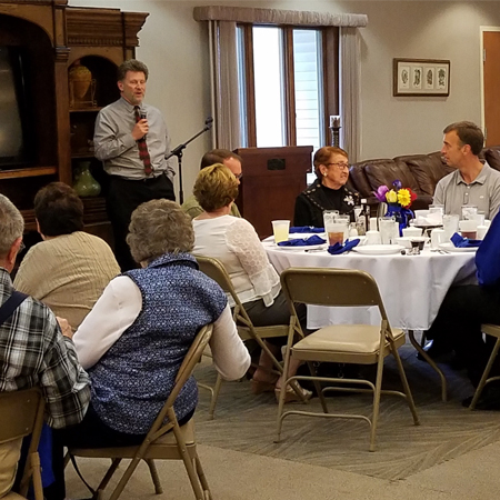 Tom Lacina, St. Francis Manor Foundation Vice-Chair, shares a brief history of St. Francis Manor during an Appreciation Dinner held on May 3.