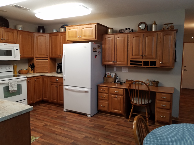 Kitchen includes appliance garage, pull-out double trash/recycling bin, two corner turntable cabinets.