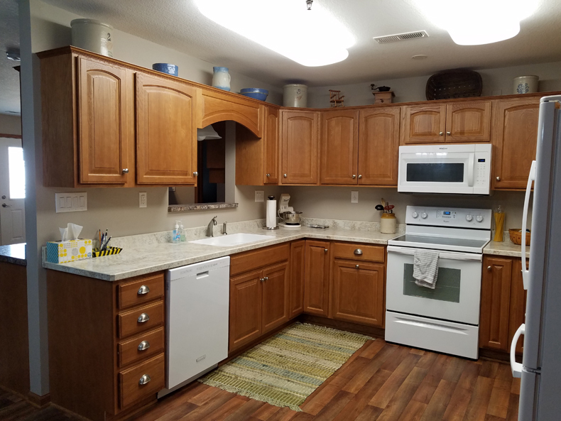 The open kitchen area has quality countertops and cabinets.